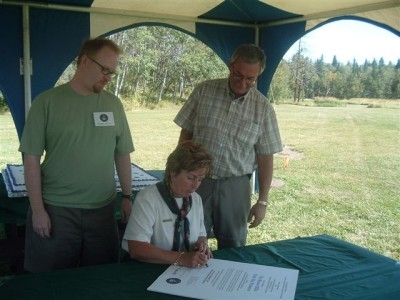 Beaver Hills DSP Declaration signed by Marilyn Peckett, Park Superintendent flanked by Scott Young (RASC President) and Roger Reilander, Area Manager, Alberta Parks.