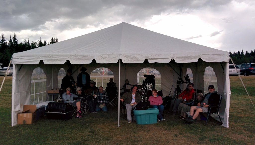 Astronomers hunker down, waiting for the rain to pass. by Luca Vanzella.